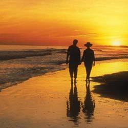 sunset over the ocean at sunset beach north carolina